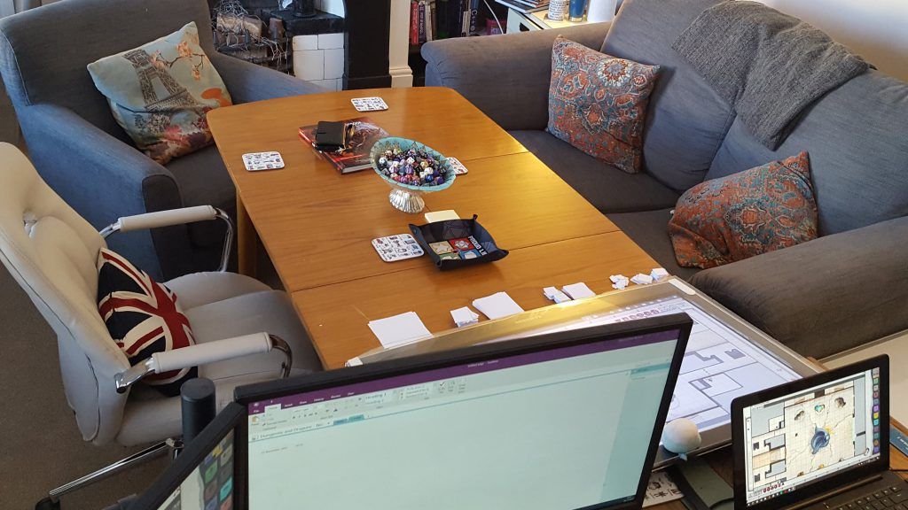 Shows our in player set up. Comfy sofas, screens, dice bowl